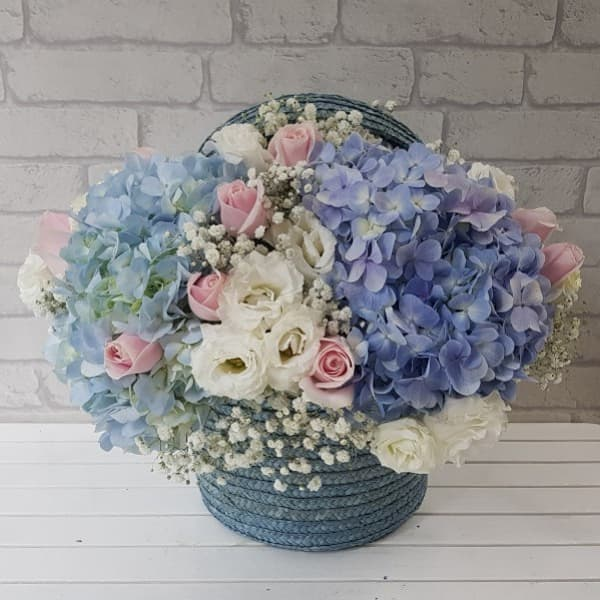 Hydrangeas, Roses and Eustomas in Basket by PURE SEED